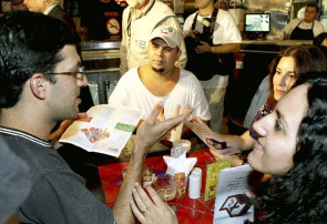 Customers in bar Paulo discuss the Anti-Smoking Law. Purpose of the law is to combat passive smoking, third leading cause of preventable death according to WHO