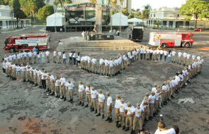 Firefighters perform choreography, heart-shaped during the Flash Mob in Goiás