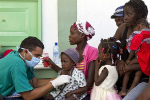 Children with cholera receiving care at the Medical Center in L'Estere near Port au Prince, Haiti