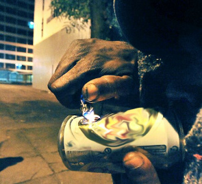 Homeless consuming crack. Brazil represents 20% of global consumption of drugs