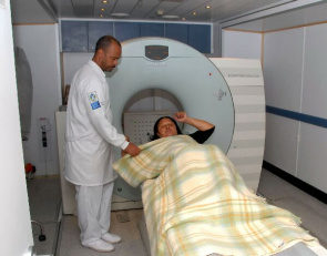Patient during tomography in mobile unit in Rio de Janeiro
