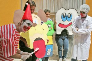 Dentists perform educational intervention on oral hygiene as brushing and mouth rinse