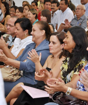 Audience watches the signing of contracts for public action