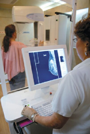 Patient performs breast ultrasound examination